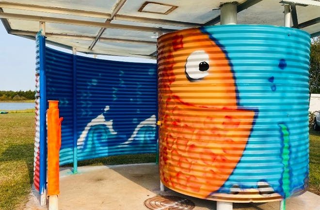 A couple city-owned buildings at Shawnee Twin Lakes were recently painted as a collaborative art project.