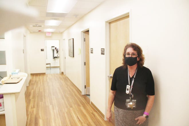 Fairchild Primary Care Manager Pat Embury stands in the expanded clinic, which was made necessary by a number of new patients and referrals.