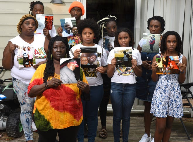 Paula Davis, bottom left, mother of Brandon Smith, stands with fellow family members, including Smith's sisters Georgia Davis, left, and Latonya Banks, second from right, and his sister-in-law Chrstal Hooper, second from left, at the home of Davis in Wilmington, N.C., Saturday, September 6, 2020. Officers with New Hanover County Sheriff's Office shot and killed Brandon Smith in Castle Hayne in 2013 following a manhunt after Smith allegedly shot an officer in the Creekwood neighborhood of Wilmington.