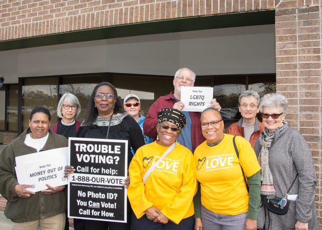 Supporters of the Souls To The Polls event gather outside the early voting location at the New Hanover County Government center on March 6, 2016.