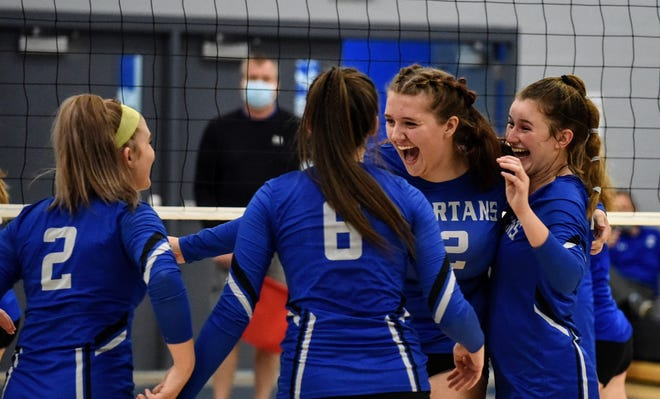 Collins-Maxwell's Rachael Purdy (rear center) celebrates with her teammates after scoring the final point of the Spartans' match against Colo-NESCO Oct. 8 in Maxwell. Collins-Maxwell swept the Royals to improve its Iowa Star Conference South Division record to 3-2.