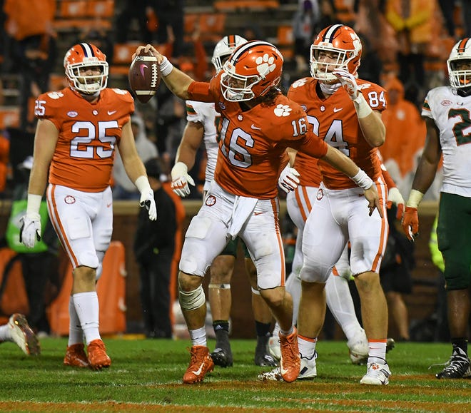 Clemson quarterback Trevor Lawrence (16) spikes the ball after scoring against Miami during the 3rd quarter of Clemson's game on Saturday, October 10, 2020.