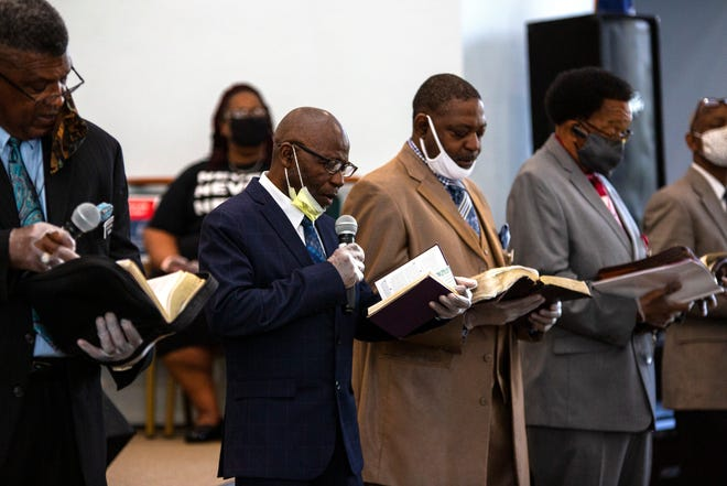 The deacons of DaySpring Baptist Church lead devotion during the Sunday morning worship service at the church celebrating its 106th anniversary. [Photos For The Guardian by Sam Thomas]