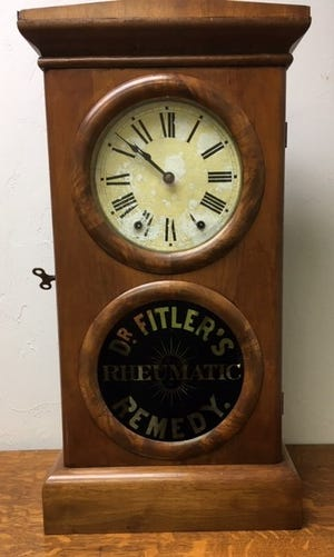 This advertising clock case has the typical look of American made clocks of the late 19th century to early 1900s.