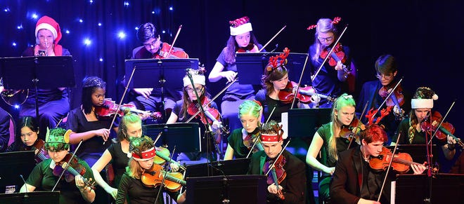 Members of the Etowah Youth Orchestras perform Dec. 7, 2019 during their annual Rock & Roll Christmas in the Wallace Fine Arts Center at Gadsden State Community College. The EYO is hosting its annual summer strings camp from June 7-11 in Gadsden.