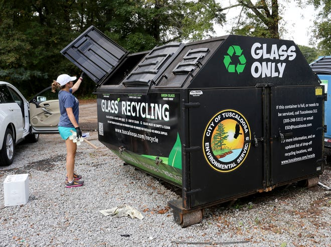 Lauren Jones uses a recycling location at the Mildred Westervelt Warner Transportation Museum in Tuscaloosa Monday, Oct. 12, 2020. Curbside recycling was suspended by the City of Tuscaloosa and has not yet restarted. [Staff Photo/Gary Cosby Jr.]