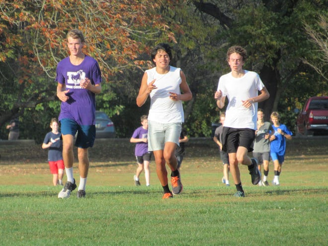 DeSales boys cross country runners, from left, Isaiah Rush, Adam Weithman and Aidan Shannon run together during practice Oct. 12 at the Park of Roses. Both the boys and girls team have run as a tight pack throughout the season and alternated their top finishers. Shannon was the boys team's top runner three times and Weithman twice before the CCL meet Oct. 17.
