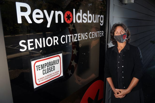 Judy Doran, senior center manager, is shown outside the Reynoldsburg Senior Citizens Center on Oct. 9. Preparations continue for reopening  the facility amid the COVID-19 coronavirus pandemic. Although the facility won't fully reopen until 2021, the staff has found alternative ways to engage with seniors through Zoom conference calls and drive-thru programs.