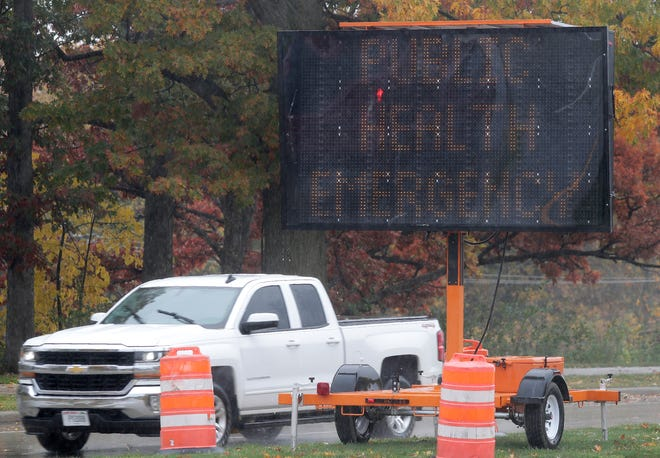 A sign warns of a public health emergency at the east end of the College Avenue bridge on Monday, October 12, 2020, in Appleton, Wis.