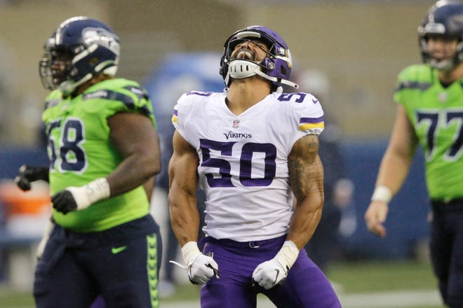 Minnesota Vikings outside linebacker Eric Wilson reacts after sacking Seattle Seahawks quarterback Russell Wilson during the first half of an NFL football game, Sunday, Oct. 11, 2020, in Seattle. (AP Photo/John Froschauer)