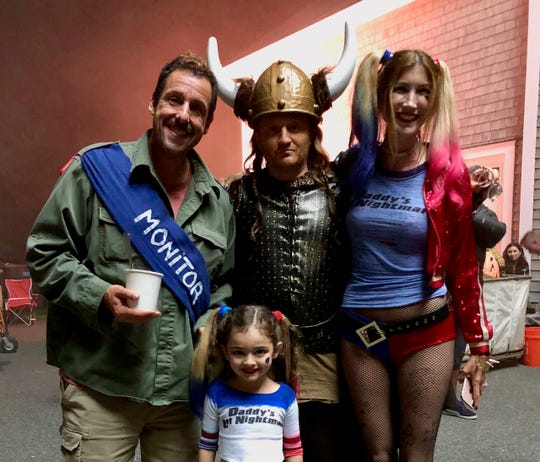 "Ella Grace Helton, a 7-year-old Brevard resident, makes her feature film debut as Jessa Phillips in ""Hubie Halloween,"" starring Adam Sandler, back left. They're pictured with Paul Sado, as Jessa's father, and Jackie Sandler, Adam Sandler's wife, who plays Jessa's mother. The movie, available on Netflix, was released Oct. 7 and as of Oct. 9, topped the Netflix Top 10 rankings."
