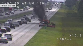 All lanes of Interstate 95 were closed temporarily between State Road 404 and Eau Gallie Boulevard after a vehicle fire, according to traffic reports.