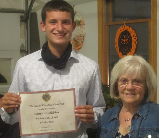 Mason McKibben with Lions Student of the Month Committee Co-Chair Becky Napier.