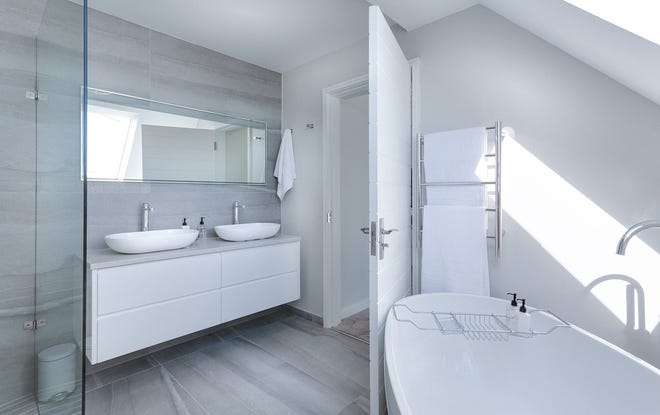 Many homeowners crave a modern bathroom makeover, a Houzz survey says.
