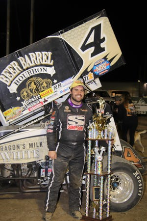 Cap Henry celebrates with his new hardware after winning on the first night of the Jim and Joanna Ford classic at Fremont Speedway.