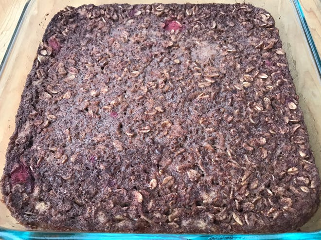 Berries, syrup and banana sweeten this oatmeal bake.