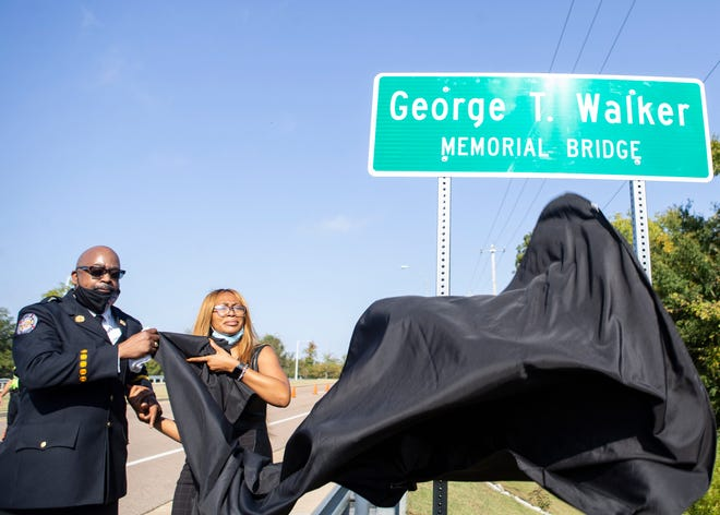 Battalion Chief Rickey Walker Sr. and Rachel Walker unveil the George T. Walker Memorial Bridge sign in remembrance of George T. Walker, Collierville's first Black police officer and alderman, in Collierville, Tenn. on Monday, October 12, 2020. Walker was murdered Dec. 9, 2001, and the case was never solved.