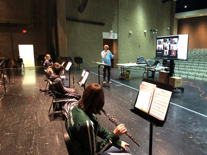 Matthew Diroff teaches band students both in-person and remote, at Novi High School on Oct. 8, 2020.