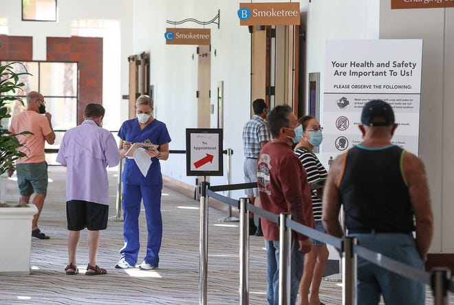People wait to be tested for Covid-19 at the Palm Springs Convention Center where free testing is available between October 12-14, through the Riverside University Health System, October 12, 2020.