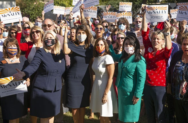 Former U.N. ambassador and South Carolina Gov. Nikki Haley, second from left, campaigns for U.S. Sen. Martha McSally at a private event in Scottsdale, Arizona, in October 2020.