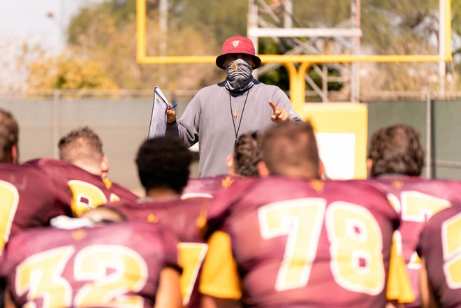 Head coach Herm Edwards talks to the team during ASU Sun Devils football practice Monday, Oct. 12, 2020.