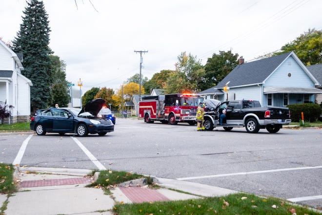 Crews responded to a two-vehicle crash Monday, Oct. 12, 2020, that briefly closed Stone Street in Port Huron. A mother and her child were transported with minor injuries.