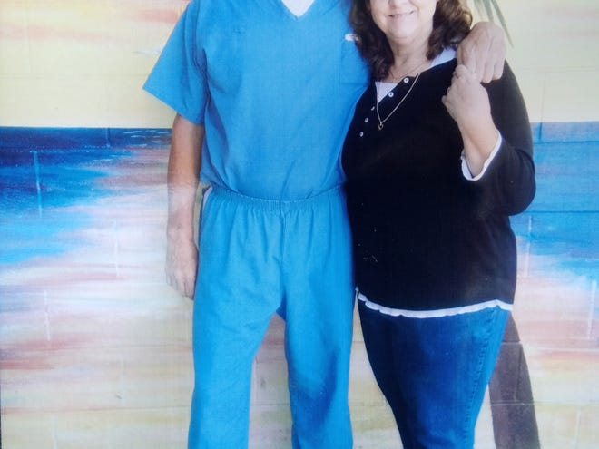 Karen Smith Gates poses with her brother, Kayle Smith, an inmate at Wakulla Correctional Institution.
