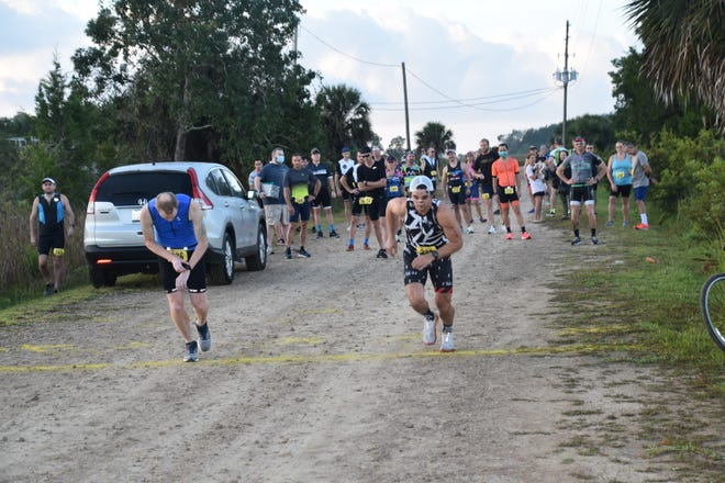 Participants compete in the Gulf Winds Track Club's St. Marks Duathlon 2020.