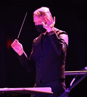 Sequoia Symphony Orchestra Music Director Bruce Kiesling conducts a virtual concert at the Visalia Fox Theatre.