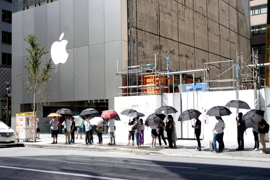 Standing on line outside an Apple Store in Tokyo