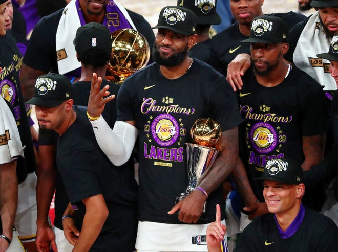 LeBron James raises four fingers to signify the four NBA World Championships he's earned his career after the Los Angeles Lakers beat the Miami Heat in six games in this year's NBA Finals that were completed this week.