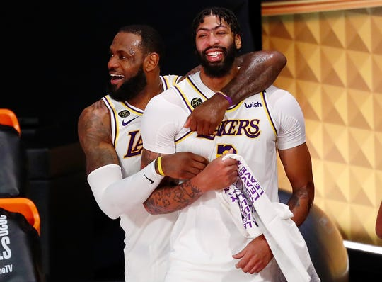 LeBron James and Anthony Davis are champions in their first season together with the Lakers.