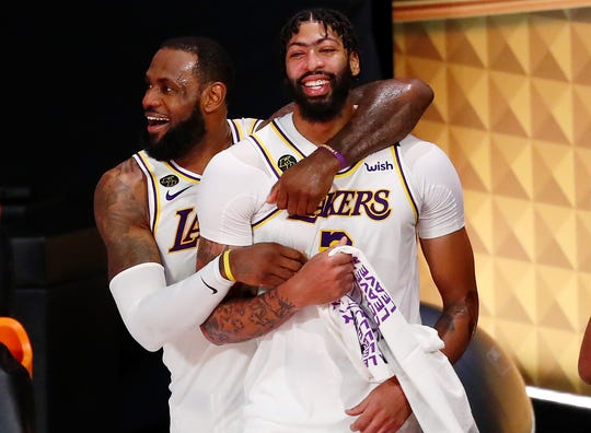 LeBron James and Anthony Davis celebrate as the finals seconds wind down on the Lakers' title.