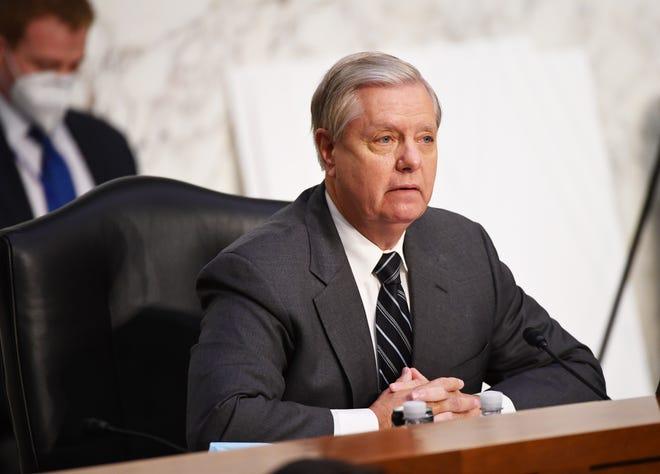 Senate Judiciary Committee Chairman Sen. Lindsey Graham, R-S.C., waits for the start of the Senate Judiciary Committee confirmation hearing for Amy Coney Barrett on Monday