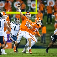 Clemson quarterback Trevor Lawrence throws a pass during this team's game against Virginia at Memorial Stadium.