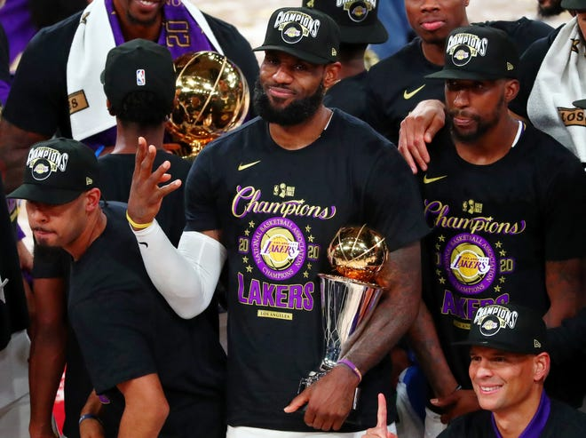 Make it four career titles for LeBron James, who holds the trophy after the Los Angeles Lakers defeated the Miami Heat in Game 6 of the NBA Finals. [Kim Klement/USA TODAY Sports]