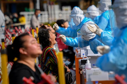 A health worker takes a swab from a resident to be tested for the COVID-19 coronavirus in Qingdao, China on Oct. 12, 2020.