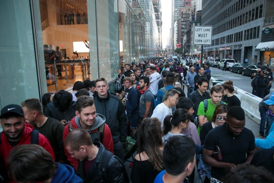 NEW YORK, NY - SEPTEMBER 22: Customers wait in line for the doors to open at the Fifth Avenue Apple Store, September 22, 2017 in New York City. The new iPhone 8 and iPhone 8 Plus, as well as the updated Apple Watch and Apple TV, went on sale.