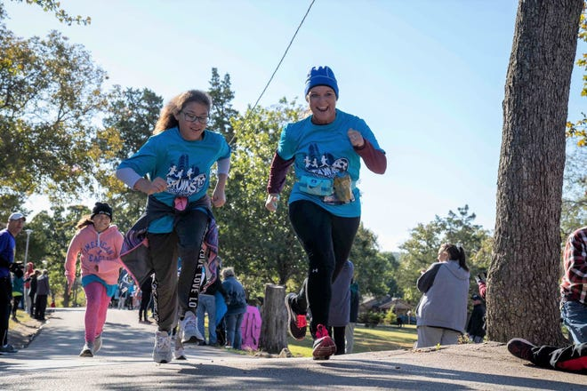 Bartlesville student Izora Frisbee and mentor Ashley Burson participate in a race as part of Bruins on the Run, a free afterschool running club for 5th-graders.
