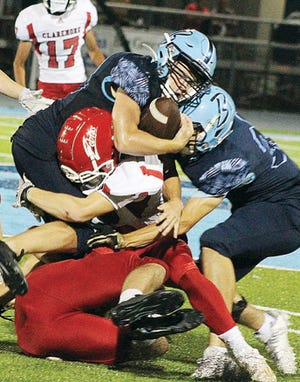 Bartlesville high tailback Dylan McCoy powers toward the goal line during Bruin football action.