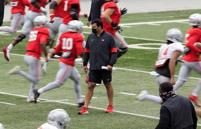 Ohio State coach Ryan Day watches the Buckeyes warm up for practice on Oct. 3 in Ohio Stadium. Day said watching other college football teams and even his son's youth league team play has been very tough for him and his team.