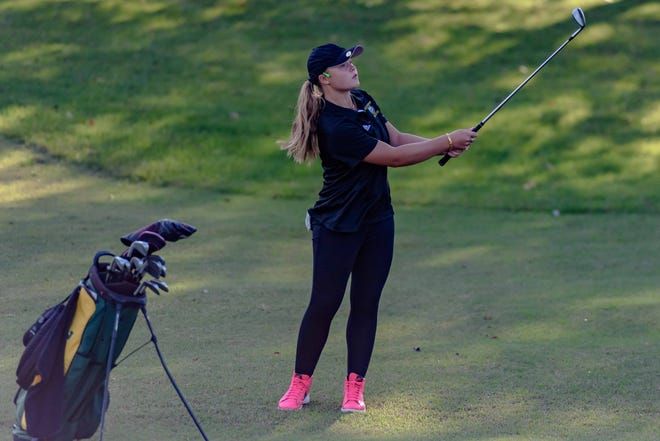 Rock Bridge's Siena Minor follows her chip shot during a tournament Oct. 1 at Lake of the Woods Golf Course. Minor led the Bruins to a district title Monday.