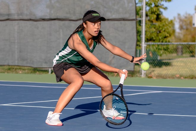 Rock Bridge's Maggie Lin returns the ball during a Class 3 team sectional Monday at Cosmo-Bethel Park.