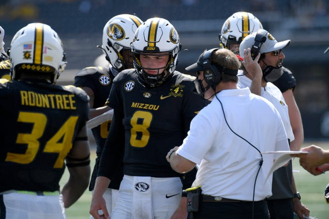 Missouri head coach Eli Drinkwitz talks with quarterback Connor Bazelak (8) during a Southeastern Conference game against LSU on Saturday at Faurot Field.