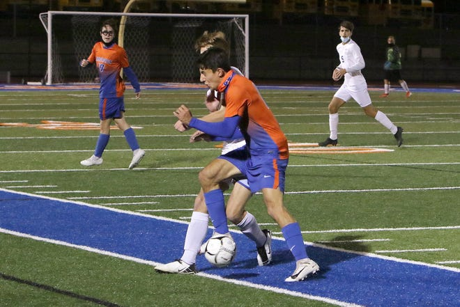 P.Y.'s #14 Tyler Griffin makes body contact with the Wayne player.