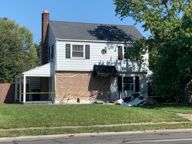 A Bexley home on East Livingston Avenue shows damage after a car recently crashed into the structure on the north side of the busy, four-lane street where residents say that speeding, weaving and aggressive and distracted driving have been threatening safety for years.