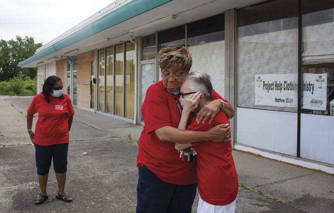 Sandy Waters-Holley hugs volunteer Mary Fewlass at the office of Project Help. Waters-Holley was named the overall Everyday Hero by the Dispatch Media Group on Tuesday.