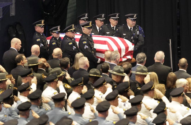 Funeral services were held Nov. 12, 2019, at the University of Dayton Arena for Dayton Police Detective Jorge Del Rio. Del Rio died days after he was shot Nov. 4 while working with a federal drug task force serving a search warrant. [Lisa Powell/Dayton Daily News]