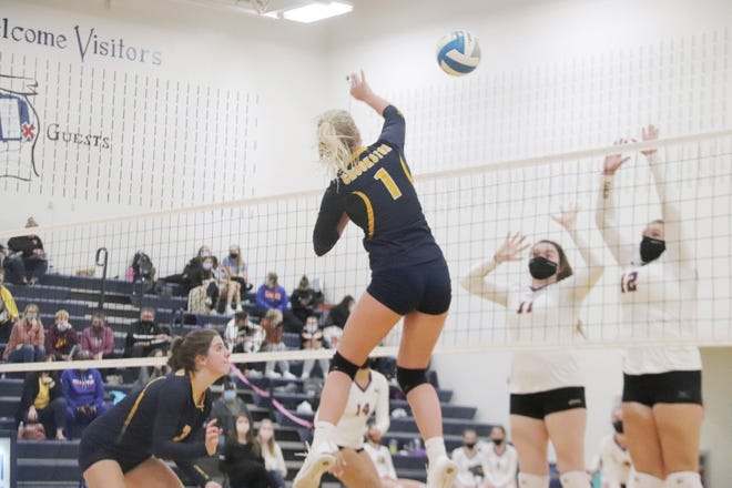 Rylee Solheim goes up for a kill during Crookston's 3-0 loss to Sacred Heart on Monday.