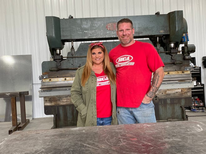 Loreal and Bryce Holmes pose for a photo inside MCA Metal Fabricator. The business recently relocated to a new building in De Soto.